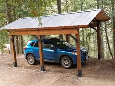 Timberframe carport with steel trusses, braces and boots. Available in Canada.