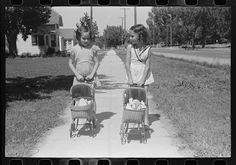 """Little girls with their dolls and buggies. Caldwell, Idaho"" Photographer: Russell Lee, Date: June-July 1941 