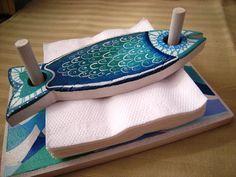Wooden napkin holder NanetteHudgens for the lake house!~ Wooden Fish Napkin Holder- Prevents wind from blowing away.Pottery fish tray napkin holder - could be other shapes, too.Great gift option- useful, flexible for various designs, easily branded. Hand Built Pottery, Slab Pottery, Ceramic Pottery, Ceramic Art, Pottery Art, Clay Projects, Clay Crafts, Wood Crafts, Ceramics Projects