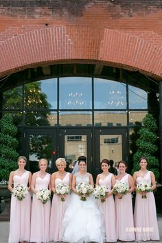 Beautiful bridesmaids in soft pink dresses. | Photo by Jeannine Marie Photography