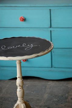 Sweet side table with chalkboard top. Cool blue dresser in the background. #diy #home #decor