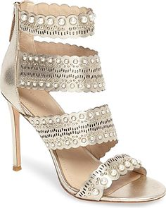 Pour la Victoire Women's Shoes in Champagne Leather Color. Tiny dome studs and lustrous imitation pearls punctuate the laddered, scalloped straps of a graceful sandal lifted by a slim stiletto.