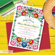 Mexican Fiesta Baby Shower Invitation  Having a Mexican Fiesta Baby Shower for ONE HOT MAMA? This invitation might just be the perfect fit! The colorful flowers on this fiesta invitation were inspired by the embroidered dresses found all over the beautiful country of Mexico. We think they add some spicy flair and a traditional Mexican vibe to any pachanga!