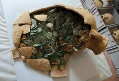 The coins, stored in containers. appear never to have been in circulation so they are in remarkably pristine condition. Some 1,300 pounds of bronze Roman coins dating to the 3rd and 4th centuries h…