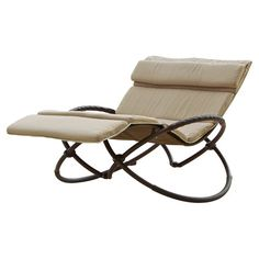 Outdoor double-wide rocking lounger with beige cushions.    Product: LoungerConstruction Material: Polyethylene r...