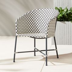 On sale. Shop Brava Outdoor Wicker Dining Chair. All-weather wicker hand woven into a modern diamond pattern in elegant black and white. Designed by Mermelada Estudio to give personality and energy to any space outdoors or in.