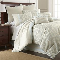 Lend a sophisticated touch to your master suite with this inviting comforter set, showcasing a scrolling floral motif in cream and aqua.