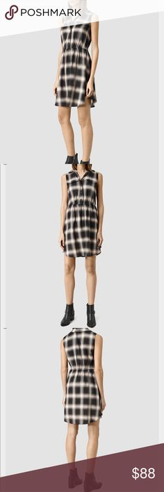 """All Saints Itaca Dress in Black Check Join the style ranks in ALLSAINTS's fluid utility dress, featuring chest pockets and a surplus-inspired hue in a nod to the season's military mood. Fits slim, if between sizes, order one size up Designed for a slim fit Point collar, sleeveless, two chest flap pockets Elasticized waist, curved hem, pullover style Bust armpit to armpit 18"""" Waist not stretched 14"""" stretches to 17"""" Length 36 1/2""""  Viscose Dry clean Imported Web ID: 1705963 All Saints Dresses…"""