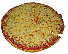 Circular cheese pizza, once slice slightly lifted