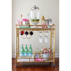 10 Beautifully Styled Bar Carts Worth Throwing a Party For ❤ liked on Polyvore featuring home ve kitchen & dining