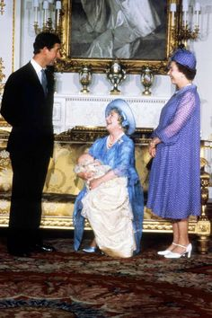 The Queen Mother, holding Prince William, laughs with the Prince of Wales and Queen Elizabeth II as the Royal Family gathered for the Prince's Christening