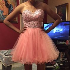 Prom/Homecoming Dress Beautiful pink/peach color dress.  Size S.  Only worn once for about 3 hours. The first picture shows more the true color of the dress. If interested in making an offer, please use the offer option!! Dresses