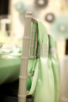 Mint green chair covers with rhinestone accents Decor by Essence of Events, LLC