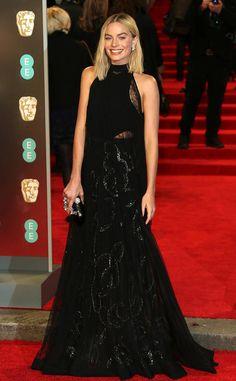 Margot Robbie from 2018 BAFTA Film Awards: Red Carpet Arrivals  TheI, Tonya star wears a black, high-neck haltergown.