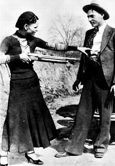 Bonnie and Clyde in a photo found at one of their hide outs after a police raid. 1933
