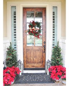 I just stepped outside to water my poinsettias, and I'm pretty sure it's about 70 degrees.  I don't think there's any chance of a white Christmas here.  Sigh.  Oh well, a girl can dream.  I hope you're all enjoying your Friday! • • #christmasporch #christmasentry #christmasdecor #holidaydecor