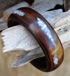 ebony bent wood ring with rustic pearl inlay