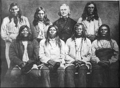 Kalispel, Skitswish, Salish & Colville men pose with Father De Smet after the journey to Vancouver in 1859