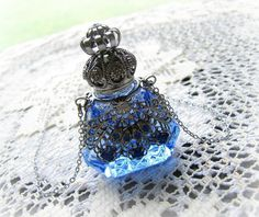 Glass Perfume Bottle Necklace Sapphire Blue Filigree Wrapped With Glass Stones Antiqued Silver