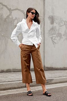 Your Guide To Wearing Neutral Colors This Spring: Fashion blogger 'Harper & Harley' wearing a white wrap blouse, brown culottes, black sandals and black cat eye sunglasses.