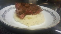 Stuffed steak and bacon roll on a bed of pepper and garlic mash