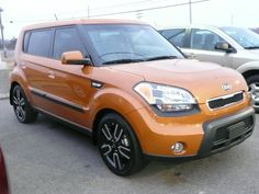 I love the colour orange....and I LOVE my orange Kia Soul <3