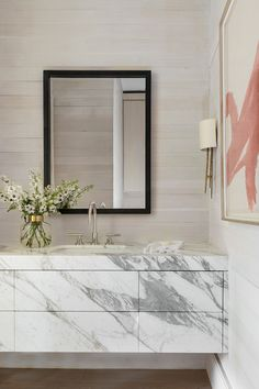 """""""Durability was of the utmost importance in this pool bathroom, but on the flip side, we wanted to ensure the bathroom would be stunning for guests. Marble-clad drawers perfectly matched with the countertop were the answer. The sconce in the corner quietly illuminates."""" Marie Flanigan. Photography by Julie Soefer. Luxury Lighting, Cool Lighting, Lighting Design, Modern Colonial, Large Table Lamps, Circa Lighting, Rectangle Table, Drapery Rods, Visual Comfort"""
