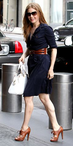 Amy Adams  WHAT SHE WORE  Adams hit the streets of New York in a navy Tory Burch shirtdress, a Cartier handbag and leather lace-ups.