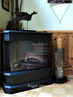 A salvaged piece of rusty stove pipe is used to create a cool, chunky, floor-standing candle pedestal.