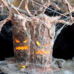 Make a Halloween tree in minutes with this technique!  Super scary and perfect for your decor!  Plus it lights up!! #halloween #halloweendecorations