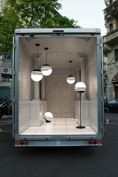 Op Art-inspired monochrome Optical lights by the British designer Lee Broom who uses a truck with the ornately molded walls of an Italian palazzo and an illuminated floor as a display  for his collection