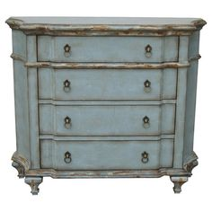Showcasing a distressed blue finish and scalloped front, this 4-drawer dresser adds antique-chic appeal to your living room or master suite.   ...