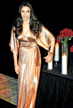 While wearing a gold outfit keep everything else minimal like Deepika Padukone does. #Bollywood #Fashion #Style #Beauty