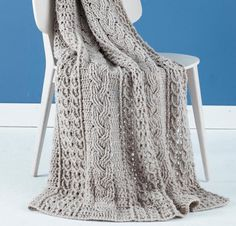 Three classic cable patterns combine to give this afghan timeless style! Your Celtic Afghan Kit includes a pattern and silky-soft skeins of Vanna's Choice yarn, for an easy-care blanket with beautiful texture. Choose from a range of sophisticated hues, and create this classic Celtic afghan today!
