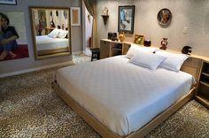 Master bedroom with leopard print carpet.