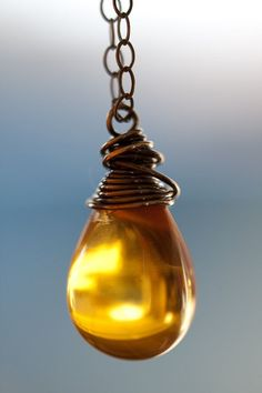 amber drop, reminds me of honey. I love this necklace.