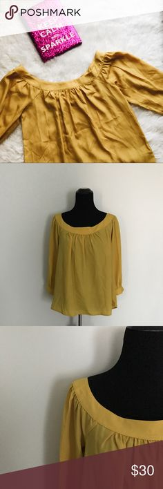 {Anthropologie} Mustard Yellow Blouse This adorable little blouse is from Maeve from Anthropologie. It's the perfect fall blouse! Very flowy and blousy. Size is an XS, but has a looser fit. Please consult measurements to ensure a proper fit.   MEASUREMENTS & MATERIAL:  Bust: 19 inches across  Sleeve length: 17 inches  Shirt length: 18 inches  100% polyester Feel free to ask for a specific measurement! Anthropologie Tops Blouses