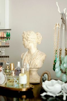 need to find a cool statue for necklace storage and a pretty tray for perfume storage... any ideas!?