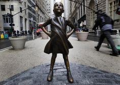 epa05835044 People are seen around a sculpture titled 'The Fearless Girl' by artist Kristen Visbal which was installed overnight facing the famous sculpture of the charging bull in Lower Manhattan by State Street Global Advisors to promote the idea of women in leadership positions in New York, New York, USA, 07 March 2017. EPA/JUSTIN LANE