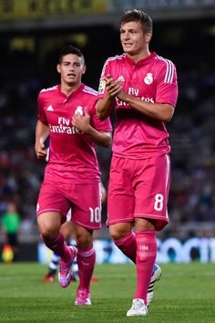 James Rodriguez and Toni Kroos of Real Madrid CF