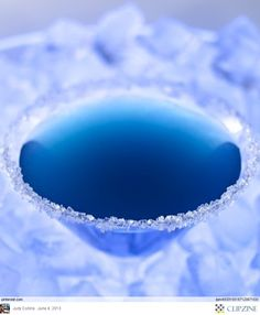 Blue Christmas (1 cup Vodka or Rum 1 cup white cranberry juice 2 ounces blue curacao (1/4 cup) 1 - 2 tablespoons fresh lime juice- in a shaker-Ice cubes, strain)