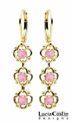Sterling Silver with 24K Yellow Gold Plated Dangle Earrings by Lucia Costin with 3 Fancy Flowers Surrounded by Dots and Light Pink Swarovski Crystals; Handmade in USA Lucia Costin. $36.00. Romantic floral design. Unique and feminine, perfect to wear for special occasions and evenings. Enriched with light rose Swarovski crystals. Produced delicately by hand, made in USA. Lucia Costin dangle earrings