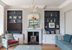 Living area | seating | symmetry in the home | chandelier | wood burner | fire place | home renovation | Victorian property | London