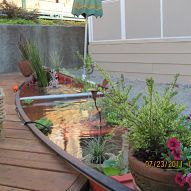 This is one of the coolest abstract pond ideas I've seen....a canoe pond
