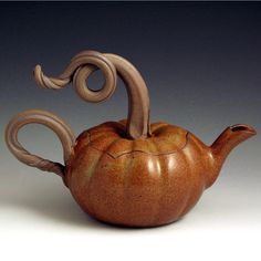 I love teapots!  I need this for my collection. Pumpkin Teapot by baumanstoneware on Etsy, $68.00