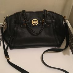Michael Kors Bag Used for maybe 2 weeks and is in excellent condition; No scratches, stains, etc! There are 4 open pockets & 1 zippered pocket inside, and one pocket on the back! Michael Kors Bags Satchels