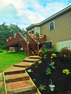 Inexpensive walkway/steps using railroad ties, pebble stones and $1.50 pavers from Lowes