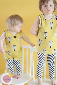 Cute zebra shirts http://en.nosh.fi/product/968/zebra-savannah-yellow-01m and leggings with diagonal stripes http://en.nosh.fi/product/960/diagonal-stripes-graphite-natural-01m