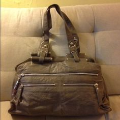 Authentic Diane Von Furstenberg Handbag Beautiful DVF leather handbag. Nice calf skin leather. Many functional pockets outside and inside. Grey color. Neutral, goes with everything. Great bag! Diane von Furstenberg Bags Shoulder Bags