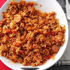 Sausage Spanish Rice Recipe -My husband and I both work the midnight shift, so I'm always on the lookout for slow cooker recipes. This one couldn't be easier. We often enjoy it as a main course because it's so hearty, but it's also good as a side dish. —Michelle McKay, Garden City, Michigan